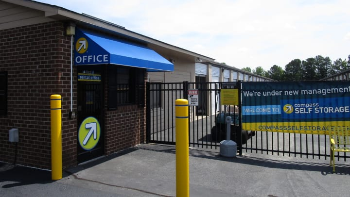 Front gate of a Compass Self Storage facility.