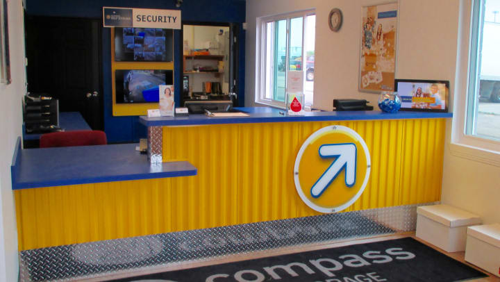 Front desk at a Compass Self Storage rental office.