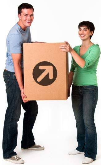 Smiling couple lifting a Compass Self Storage moving box.