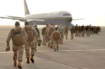 United States army troops boarding a plane for deployment.