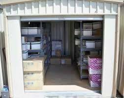 A medium sized storage unit filled with boxes.