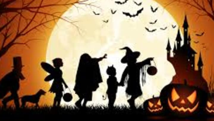 Halloween graphic depicting a group of children in costumes.