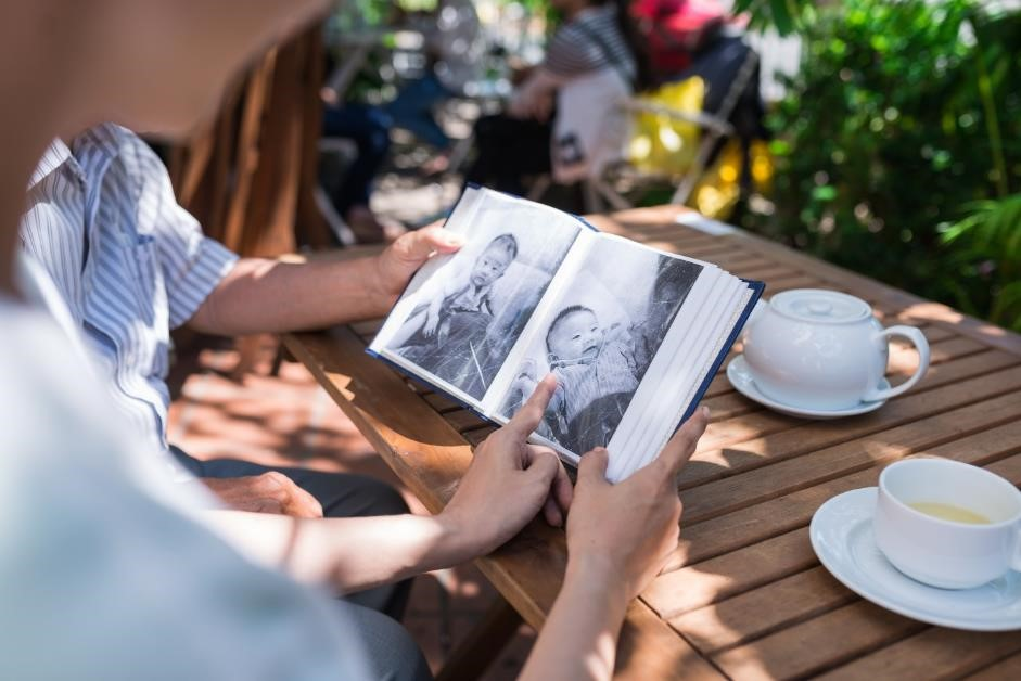 Couple looking at a baby photo album.
