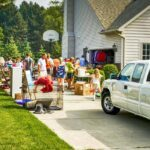 Group of people shopping at a garage sale.
