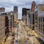 an above-street view into downtown Detroit at dusk