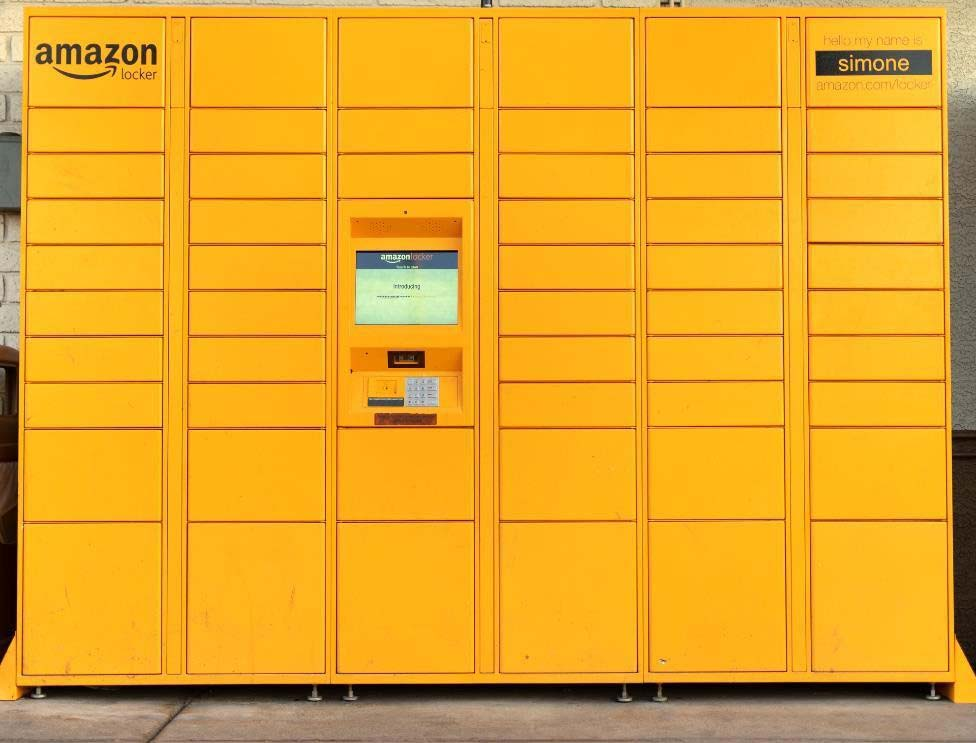 a big yellow Amazon Locker with multiple locker spaces for packages