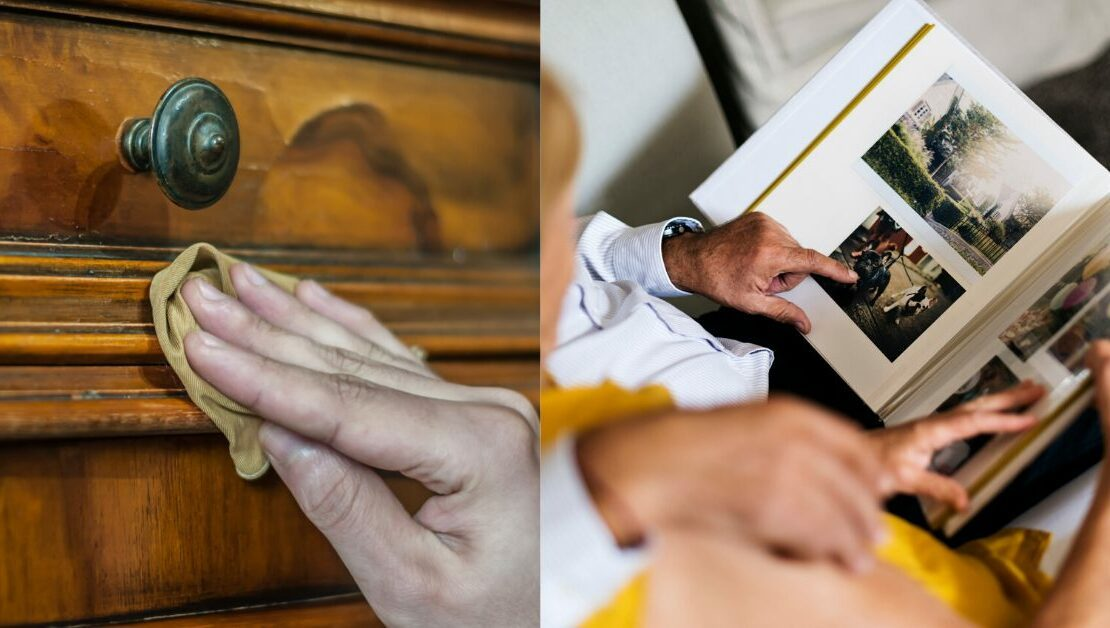 Hand wiping dust off antique furniture and elderly couple looking at an old photo album