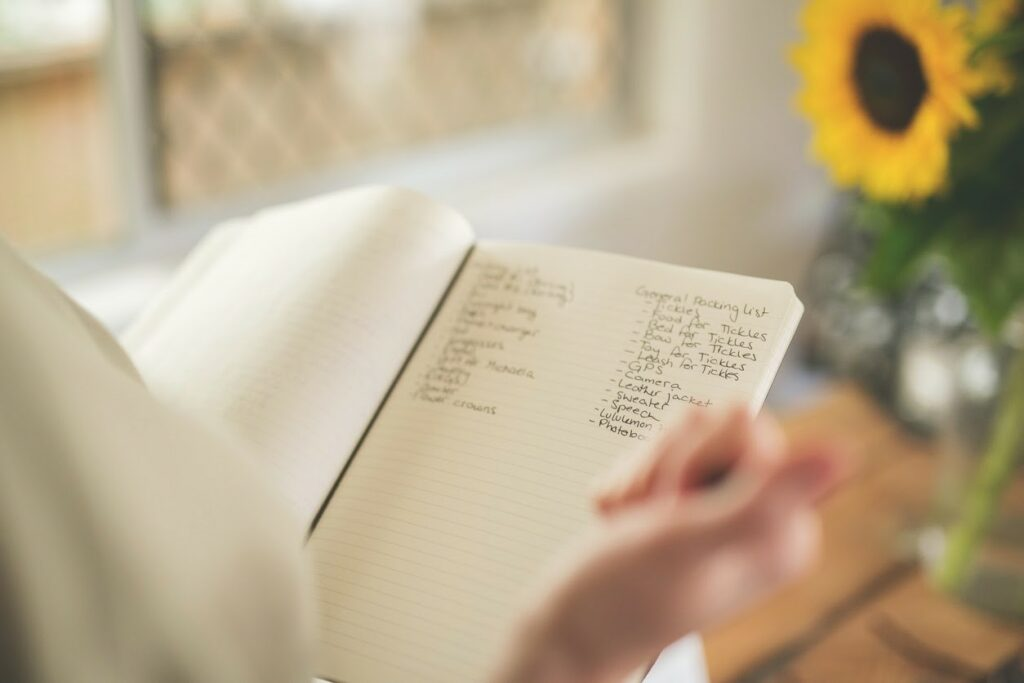 an image of a checklist in a notebook being used by someone planning an event