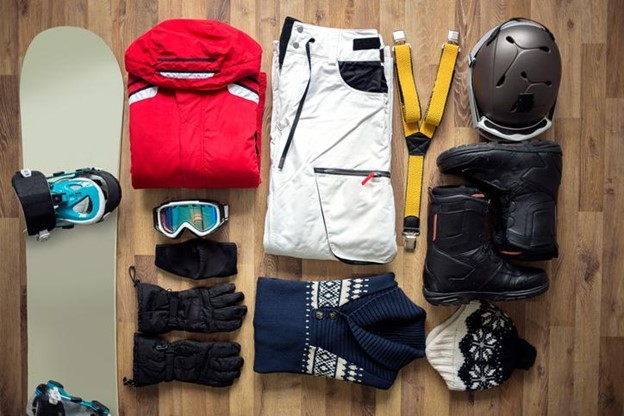 a flat-lay of outdoor winter gear and equipment